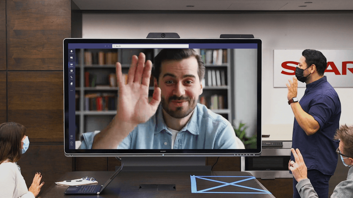 Windows Collaboration Display being used in meeting with 1 video chat participant on screen